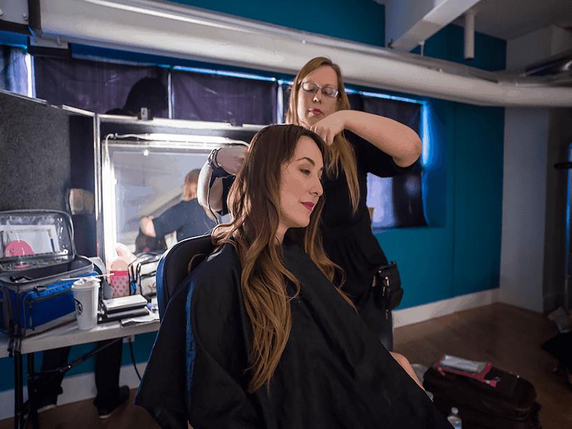 Blue Dressing Room, hair stylist doing actress's hair